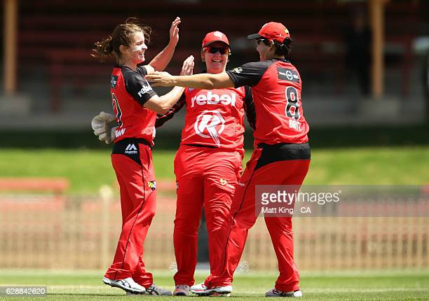 'SYDNEY AUSTRALIA DECEMBER 10 Nicole Goodwin of the Renegades celebrates with team mates after taking the wicket of Tahlia McGrath of the Strikers...