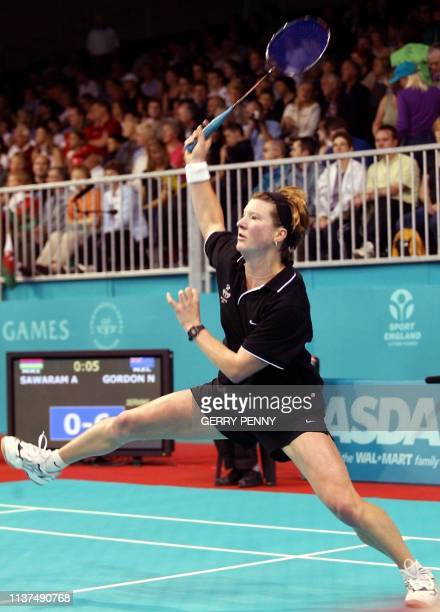 Nicole Gordon of New Zealand on her way to beating Amrita Sawaram of Mauritius 26 July 2002 in the women's singles group D match at the Bolton Arena...