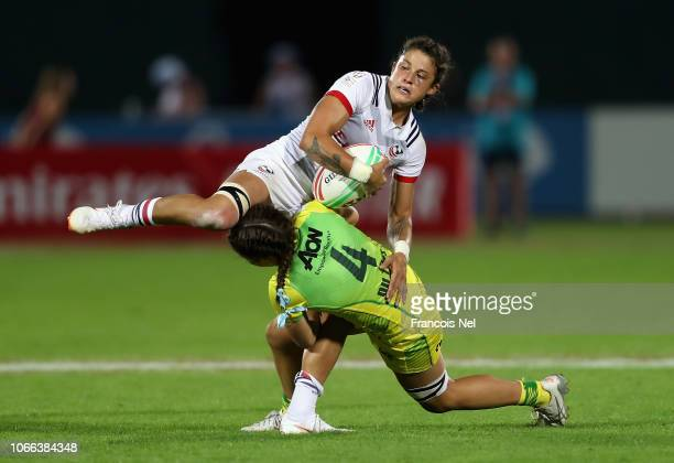 Nicole Heavirland of USA is tackled by Dominique Du Toit of Australia on day one of the Emirates Dubai Rugby Sevens HSBC World Rugby Sevens Series at...