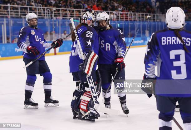 Nicole Hensley talks with Sidney Morin of the United States in the first period during the Women's Ice Hockey Preliminary Round Group A game on day...