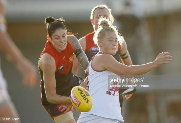 Nicole Hildebrand of the Lions and Tegan Cunningham of the Demons compete for the ball during the 2018 AFLW Round 05 match between the Melbourne...