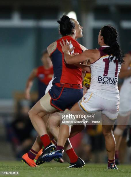 Nicole Hildebrand of the Lions and Tegan Cunningham of the Demons collide during the 2018 AFLW Round 05 match between the Melbourne Demons and the...