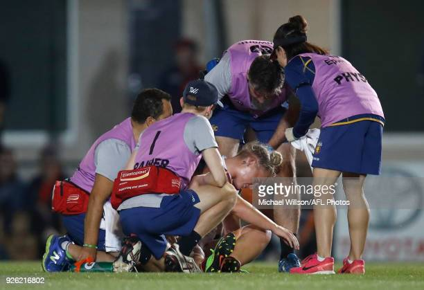 Nicole Hildebrand of the Lions is helped from the field during the 2018 AFLW Round 05 match between the Melbourne Demons and the Brisbane Lions at...
