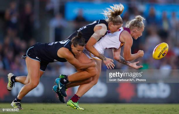 Nicole Hildebrand of the Lions is tackled by Tayla Harris of the Blues during the 2018 AFLW Round 03 match between the Carlton Blues and the Brisbane...