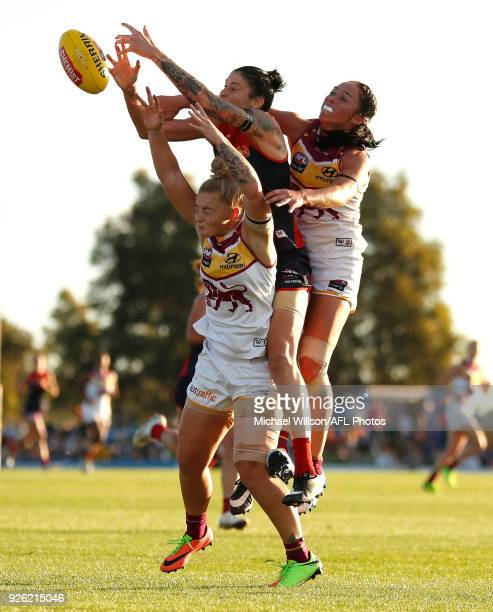 Nicole Hildebrand of the Lions Tegan Cunningham of the Demons and Leah Kaslar of the Lions compete for the ball during the 2018 AFLW Round 05 match...
