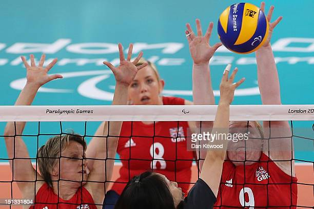 Nicole Hill of Great Britain reaches up to block a shot during the Women's Sitting Volleyball 78 Clasification match against Japan on day 8 of the...