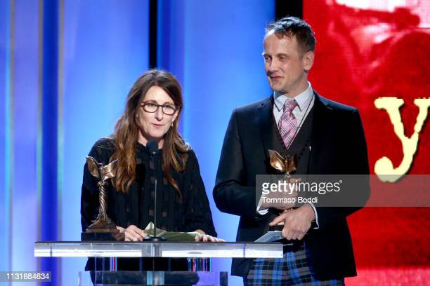 "Nicole Holofcener and Jeff Whitty accept Best Screenplay for ""Can You Ever Forgive Me"" onstage during the 2019 Film Independent Spirit Awards on..."