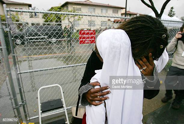 Nicole Jackson weeps as Michael Jackson arrives in an SUV for the first day of opening statements in his child molestation trial February 28 2005 in...
