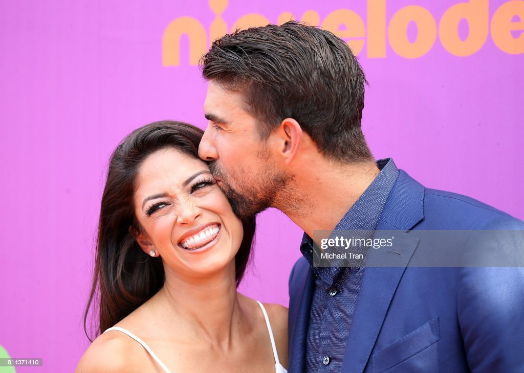 Nicole Johnson (L) and Michael Phelps arrive at Nickelodeon Kids' Choice Sports Awards 2017 held at Pauley Pavilion on July 13, 2017 in Los Angeles, California.