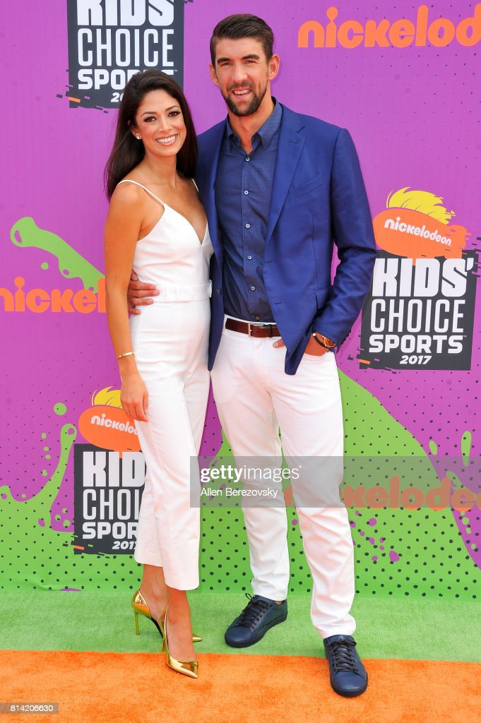 Nicole Johnson and Michael Phelps attend Nickelodeon Kids' Choice Sports Awards 2017 at Pauley Pavilion on July 13, 2017 in Los Angeles, California.