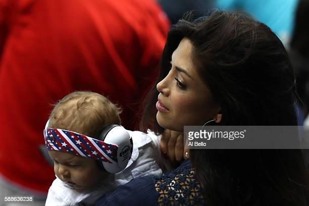 Nicole Johnson, fiancee of Michael Phelps of the United States, holds their son Boomer during the evening swim session on Day 6 of the Rio 2016...