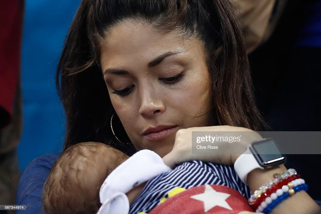 Nicole Johnson, partner of Michael Phelps of the United States, holds their son Boomer on Day 3 of the Rio 2016 Olympic Games at the Olympic Aquatics Stadium on August 8, 2016 in Rio de Janeiro, Brazil.