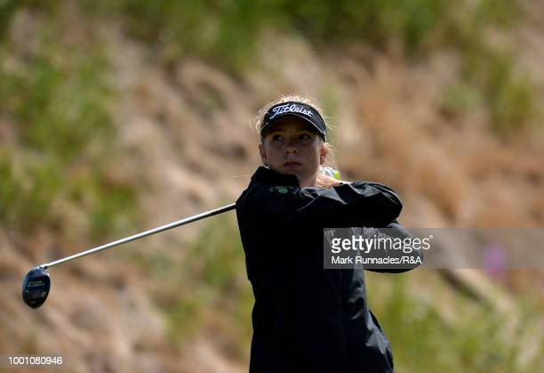 Tsubasa Kajitana of Japan plays her tee shot to the 1st hole during the final day of the The Junior Open Championship at Eden Golf Course on July 18...
