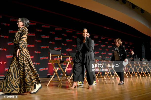 Nicole Kassell Regina King enter the stage during HBO Watchmen Screening and Panel at New York Comic Con 2019 Day 2 at Hulu Theater at Madison Square...