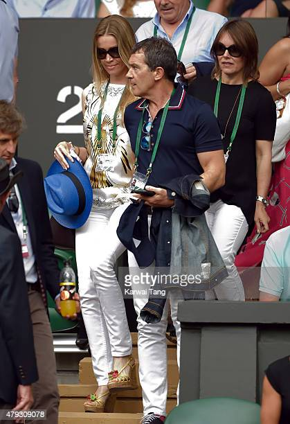 Nicole Kempel and Antonio Banderas attend the Dustin Brown v Rafael Nadal match on day four of the Wimbledon Tennis Championships at Wimbledon on...