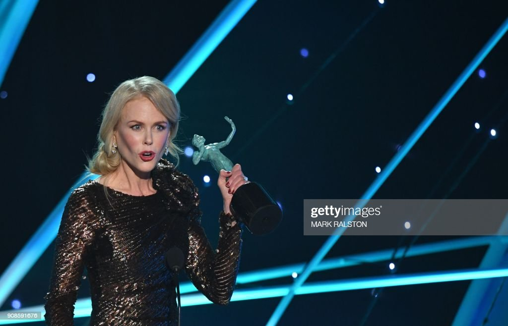 TOPSHOT - Nicole Kidman accepts the Outstanding Performance by a Female Actor in a Television Movie or Limited Series award for 'Big Little Lies' onstage during the 24th Annual Screen Actors Guild Awards show at The Shrine Auditorium on January 21, 2018 in Los Angeles, California. / AFP PHOTO / Mark RALSTON