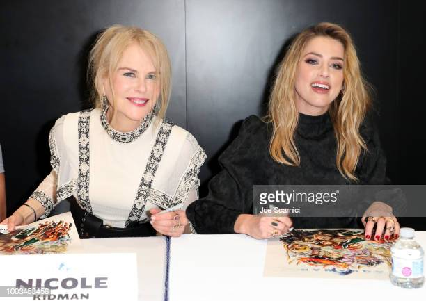 Nicole Kidman and Amber Heard attend DC Entertainment's Warner Bros Pictures 'Aquaman' Autograph Signing during ComicCon International 2018 at San...