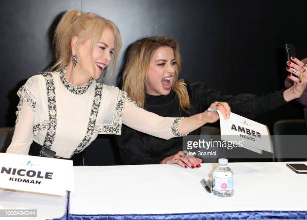 Nicole Kidman and Amber Heard take a selfie at DC Entertainment's Warner Bros Pictures 'Aquaman' Autograph Signing during ComicCon International 2018...