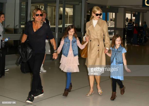 Nicole Kidman and Keith Urban arrive at Sydney airport with their daughters Faith Margaret and Sunday Rose on March 28 2017 in Sydney Australia