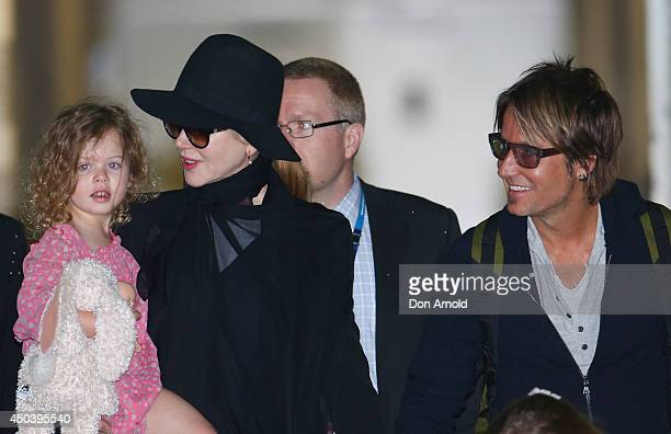 Nicole Kidman and Keith Urban arrive with daughter Faith Urban at Sydney International Airport on June 11 2014 in Sydney Australia