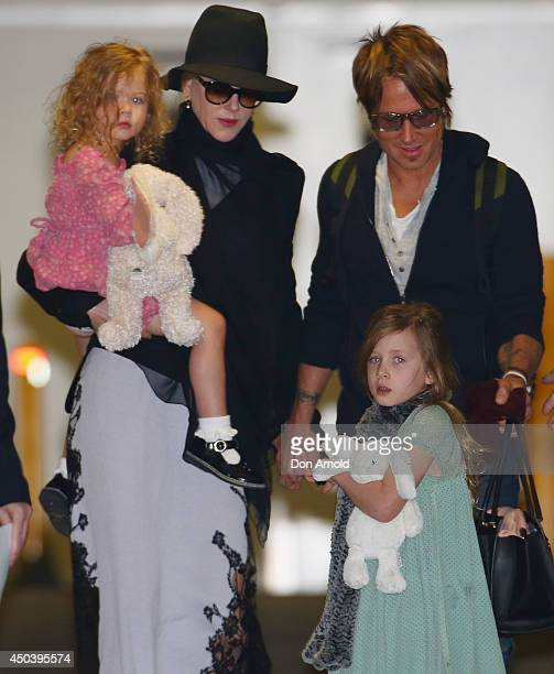 Nicole Kidman and Keith Urban arrive with daughters Faith Urban and Sunday Rose Urban at Sydney International Airport on June 11 2014 in Sydney...