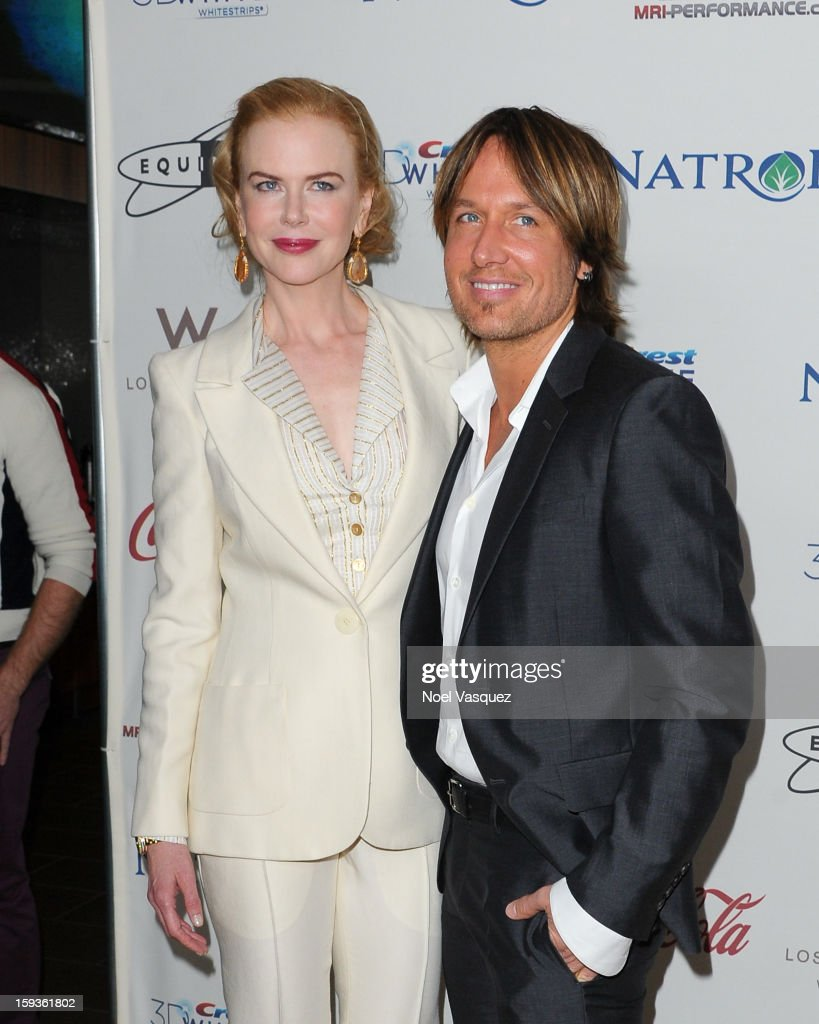 Nicole Kidman (L) and Keith Urban attend the 'Gold Meets Golden' event hosted at Equinox on January 12, 2013 in Los Angeles, California.