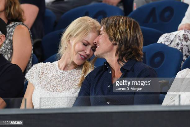 Nicole Kidman and Keith Urban share an affectionate moment during one of the women's semi finals on Rod Laver Arena as they attend the 2019...