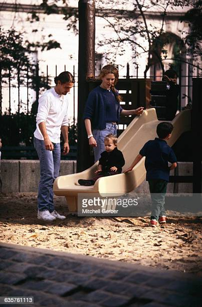 Nicole Kidman and Tom Cruise play with their daughter Isabella Jane on a slide in Central Park