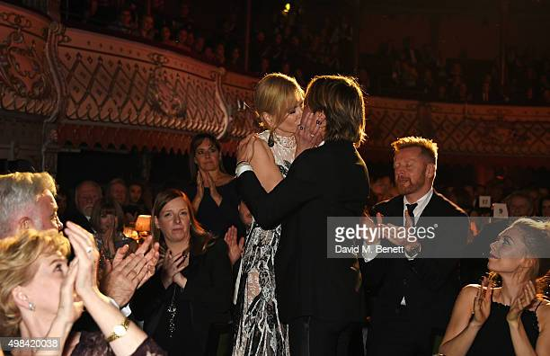Nicole Kidman kisses husband Keith Urban as she celebrates winning the Best Actress award for 'Photograph 51' at The London Evening Standard Theatre...