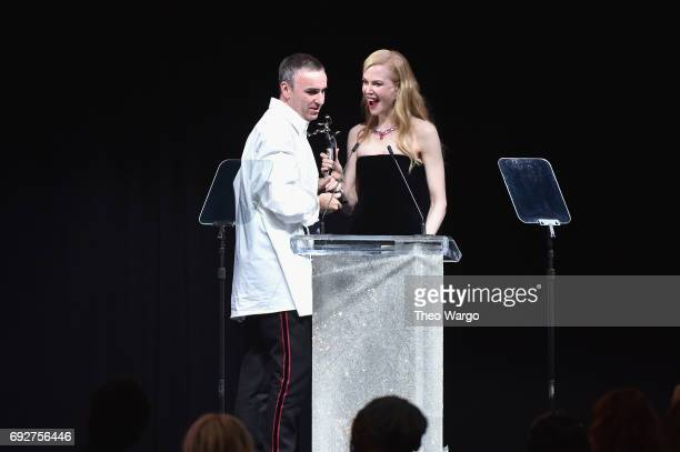 Nicole Kidman presents an award to Raf Simons onstage during the 2017 CFDA Fashion Awards at Hammerstein Ballroom on June 5 2017 in New York City
