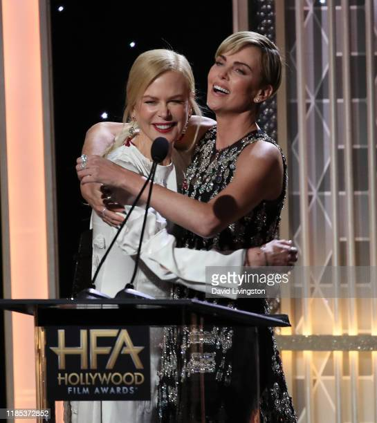 Nicole Kidman presents Charlize Theron with the Hollywood Career Achievement Award onstage during the 23rd Annual Hollywood Film Awards show at The...