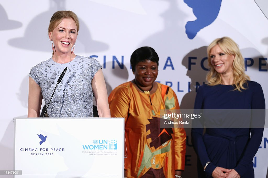 Nicole Kidman (L) speaks while Fatou Bensouda (C) and Veronica Ferres (R) smile during the Cinema for Peace UN women honorary dinner at Soho House on July 12, 2013 in Berlin, Germany.