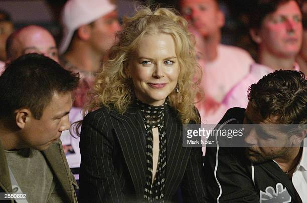 Nicole Kidman takes in the scene while Kostya Tszyu and Russel Crowe exchange conversation during the WBA Super Middle Weight Boxing Title Defence...