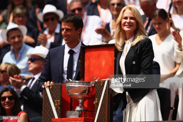 Nicole Kidman unveils the trophy inside Court Philippe Chatrier prior to the mens singles final between Rafael Nadal of Spain and Stan Wawrinka of...