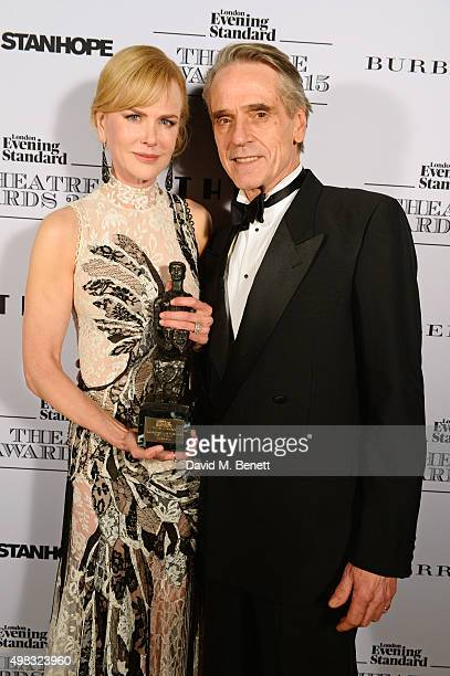 Nicole Kidman winner of Best Actress for 'Photograph 51' and Jeremy Irons pose in front of the Winners Boards at The London Evening Standard Theatre...