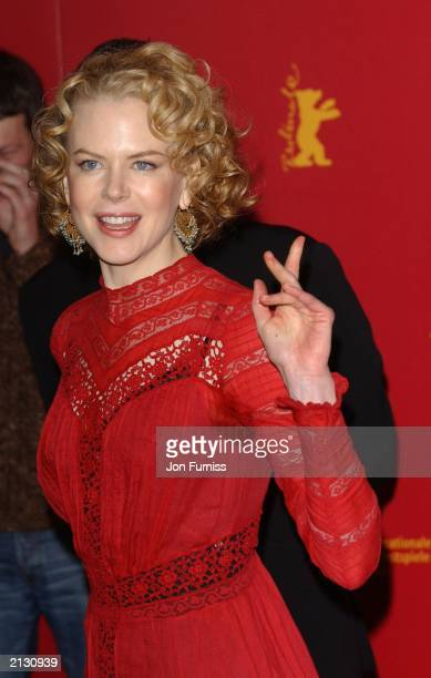 Nicole Kidman with sweat patch under arm at the photo call for the film The Hours at the 53rd Berlin Film Festival February 9 2003 Berlin Germany