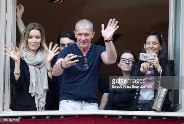 Nicole Kimpel Alex Rich and Antonio Banderas attend a procession during Holy Week celebration on March 27 2018 in Malaga Spain