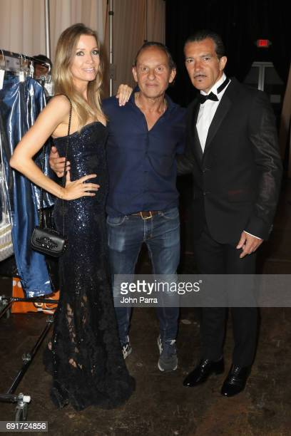 Nicole Kimpel Custo Dalmau and Antonio Banderas pose backstage at the Custo Barcelona Runway Show during Miami Fashion Week at Ice Palace Film...