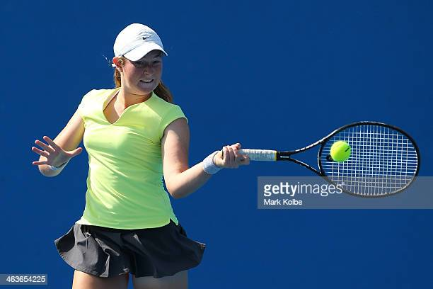 Nicole Kraemer of Australia plays a backhand in her first round junior girls' match against Jana Fett of Croatia during the 2014 Australian Open...