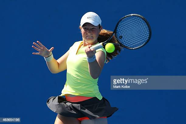 Nicole Kraemer of Australia plays a forehand in her first round junior girls' match against Jana Fett of Croatia during the 2014 Australian Open...