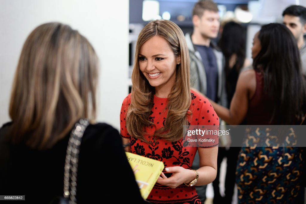 Nicole Lapin signs books at a private party to celebrate the release of her second book 'BOSS BITCH' at a private residence on March 20, 2017 in New York City.