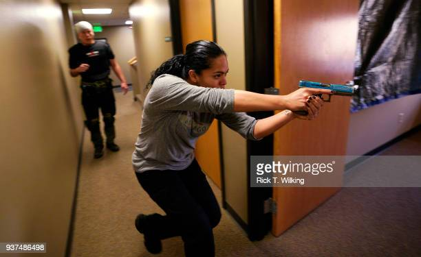 Nicole Layog former Broward County Sheriff Deputy runs through a scenario in a 'Lone Wolf' civilian active shooter response course for concealed...
