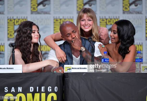 Nicole Maines Mechad Brooks Melissa Benoist and Azie Tesfai embrace at the Supergirl Special Video Presentation and QA during 2019 ComicCon...