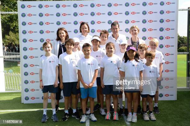 Nicole McGuinness Lindsay Davenport Tim Henman and Helen Parker with children from Give It Your Max during a Wimbledon press conference with a twist...