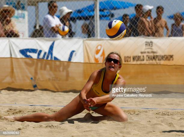 Nicole McNamara from Canada dives for the ball at the FIVB Under 21 Beach Vollyball World Championships on July 23 2014 in Larnaca Cyprus