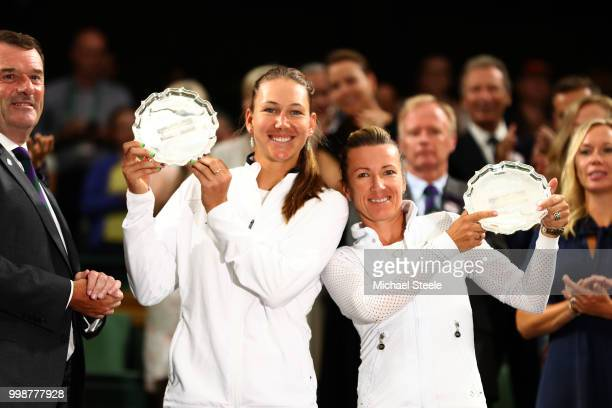Nicole Melichar of The United States and Kveta Peschke of Czech Republic pose with their runnerup trophies in Centre Court after Barbora Krejcikova...