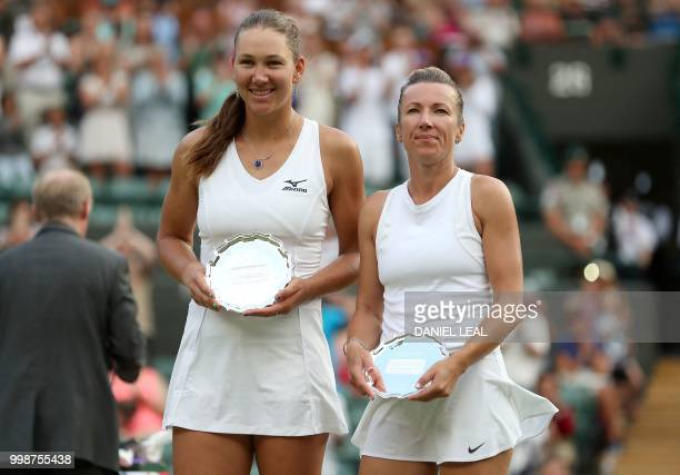 Nicole Melichar of the USA and Czech Republic's Kveta Peschke pose with their runner's up trophies after losing their ladies' doubles final match to...