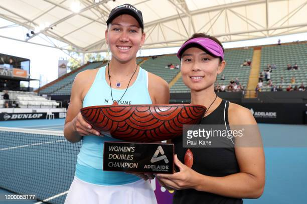 Nicole Melichar of the USA and Yifan Xu of China pose with the Adelaide International Womens Doubles trophy after winning the womens doubles finals...