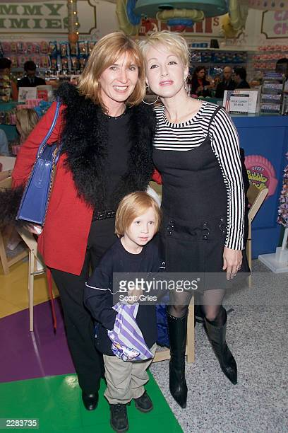 Nicole Miller with her son Palmer and Cyndi Lauper at the unveiling of the Ultimate Toy Catalog and a kiddie fashion at FAO Schwartz in New York City...