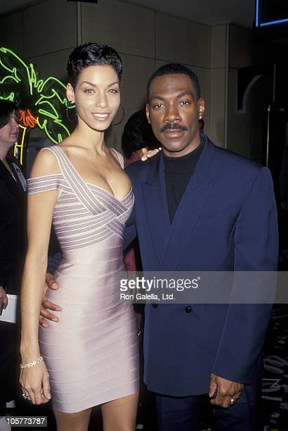 Nicole Mitchell and Eddie Murphy during NATO/Showest Conference March 10 1994 at Bally's Hotel in Las Vegas California United States